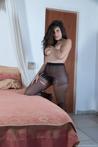 Sally is in her black stockings while resting on her peach bed and showing off her hairy pussy and 36C breasts. She lays back naked, and touches her breasts and rubs her very hairy pussy with delight.