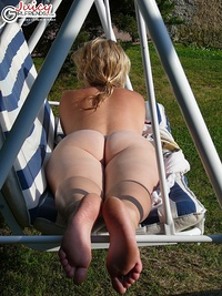 Sunbathing naked at the swimming pool