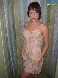 Nice girl poses in wet cloth
