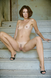 """""""Oda delightfully poses by the stairs as she flaunts her petite body with erect nipples."""""""